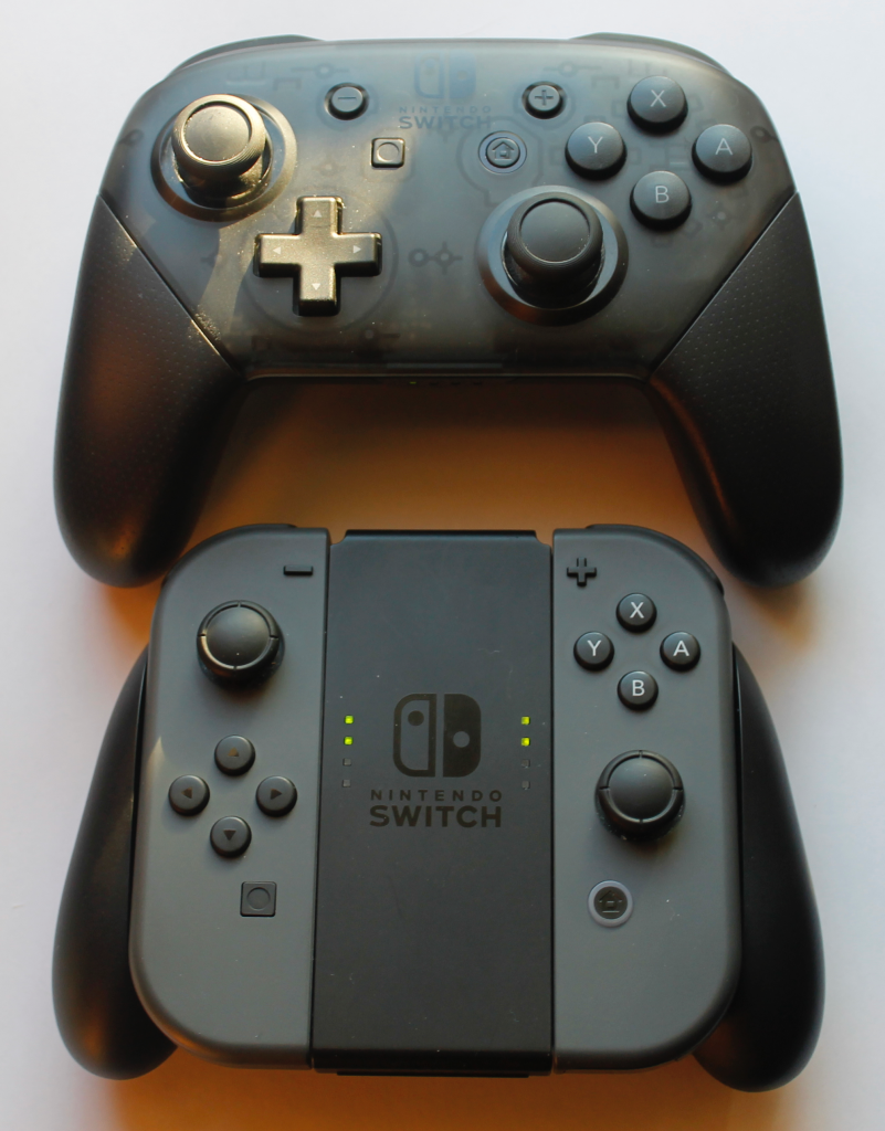 Side-by-side comparison of the Joy Con Grip and the Pro Controller.