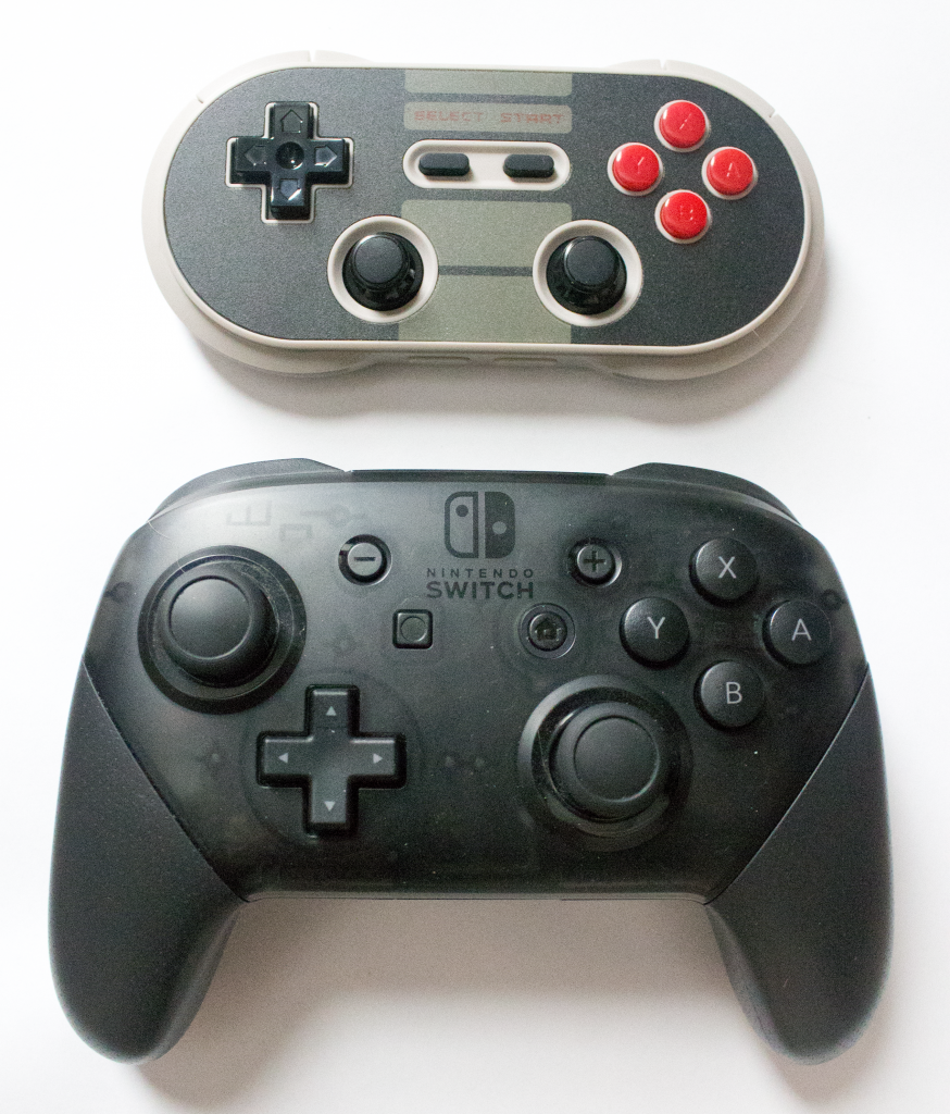 Side-by-side comparison of the 8BITDO and the Pro Controller.